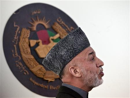 Afghan President Hamid Karzai speaks at Afghanistan's Independent Election Commission (IEC) in Kabul April 1, 2010. REUTERS/Ahmad Masood