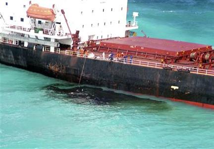Oil is seen next to the 230-metre (754-ft) bulk coal carrier Shen Neng I about 70 km (43 miles) east of Great Keppel Island April 5, 2010. REUTERS/Maritime Safety Queensland/Handout