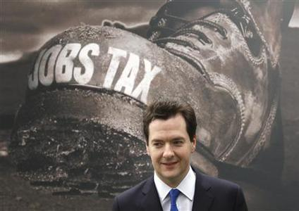 Conservative shadow chancellor George Osborne poses during the launch of the Tories' latest billboard advertisement in London April 5, 2010. REUTERS/Chris Helgren