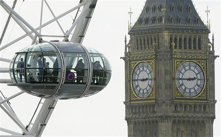 Visitors look out from a pod on the London Eye towards Big Ben and the Houses of Parliament in central London April 6, 2010. REUTERS/Toby Melville
