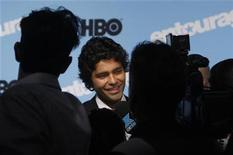 "<p>Adrian Grenier speaks to reporters as he attends the premiere of the fifth season of ""Entourage"" presented by HBO at the Ziegfeld Theater in New York September 3, 2008. REUTERS/Joshua Lott</p>"