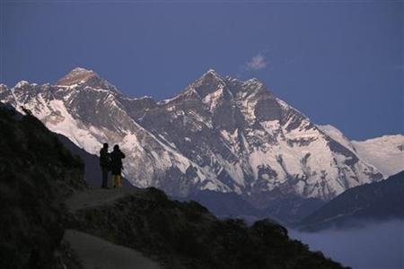Travelers enjoy the the view of Mount Everest at Syangboche in Nepal December 3, 2009. REUTERS/Gopal Chitrakar