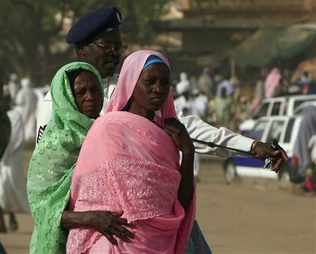 PA Policeman Directs Pedestrians On A Street In The Town Of Al Fasher Northern Darfur April 8 2010 REUTERS Zohra Bensemra P