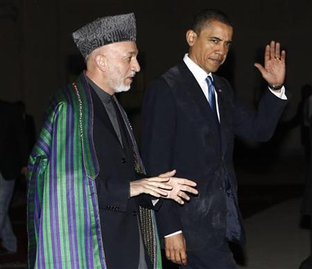 President Barack Obama meets with Afghan President Hamid Karzai at the Presidential Palace in Kabul, March 28, 2010. REUTERS/Jim Young