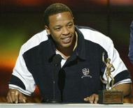 <p>Dr. Dre accepts his award for Male Entertainer of the Year during the 16th annual Soul Train Awards in Los Angeles, March 20,2002. REUTERS/Gary Hershorn</p>