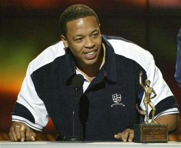 Dr. Dre accepts his award for Male Entertainer of the Year during the 16th annual Soul Train Awards in Los Angeles, March 20,2002. REUTERS/Gary Hershorn