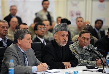 Afghan President Hamid Karzai (C) talks as U.S. Special Representative for Afghanistan and Pakistan Richard Holbrooke (L) and U.S. Central Command chief General David Petraeus (R) look on at Kabul International Airport April 11, 2010. REUTERS/Shah Marai/Pool
