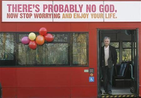 British author Richard Dawkins, who wrote The God Delusion, stands on a bus at the launch of an atheist advertising campaign, in London January 6, 2008. REUTERS/Andrew Winning