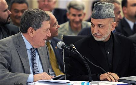 U.S. Special Representative for Afghanistan and Pakistan Richard Holbrooke (L) talks to Afghan President Hamid Karzai at Kabul International Airport April 11, 2010. REUTERS/Shah Marai/Pool