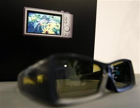 A pair of glasses used to view 3D images is seen next to a Sharp Corp 3D Touchscreen LCD panel at its unveiling ceremony in Tokyo April 2, 2010. REUTERS/Kim Kyung-Hoon