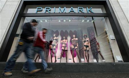 Pedestrians walk past a Primark store in London, January 14, 2010. REUTERS/Suzanne Plunkett