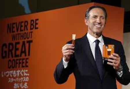 Starbucks Chief Executive Howard Schultz shows off the company's new new Via brand instant coffee during a news conference in Tokyo April 13, 2010. REUTERS/Yuriko Nakao