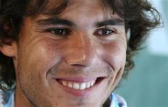 <p>Tenista espanhol Rafael Nadal sorri após derrotar o holandês Thiemo de Bakker no Masters de Monte Carlo. REUTERS/Regis Duvignau</p>