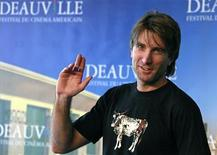 "<p>Sharlto Copley poses during a photocall for the film ""District 9"" at the 35th Deauville American film festival in Deauville September 6, 2009. REUTERS/Pascal Rossignol</p>"