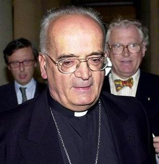 French Bishop Pierre Pican (C) leaves court with his lawyers Maitre Thierry Massis (L Rear) and Matire Alain Blanchard (R Rear) in Caen, September 4, 2001. REUTERS/Stringer