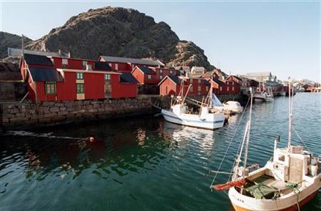 An undated general view shows the harbour in the town of Stamsund on the Norwegian Lofoten Islands. Fishing ports like this one are benefiting from repairs done by migrant workers. REUTERS/Aleksander Nordahl/Scanpix/Files