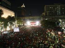 "<p>Anti-government ""red shirt"" protesters gather in the main shopping district in Bangkok April 16, 2010. REUTERS/Chaiwat Subprasom</p>"