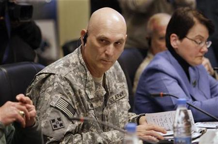 General Raymond Odierno (L), the top U.S. military commander in Iraq, and U.S. Embassy Deputy Chief of Mission Patricia A. Butenis attend a meeting between Iraqi and U.S. officials to discuss detainees in U.S. custody, in Baghdad January 15, 2009. REUTERS/Hadi Mizban/Pool