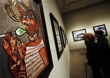 "<p>Pablo Picasso's 1938 oil painting ""Man with a Lollipop"" is seen during a media preview of 300 works by Picasso at The Metropolitan Museum of Art in New York April 19, 2010. REUTERS/Shannon Stapleton</p>"