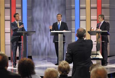Prime Minister Gordon Brown (R), Conservative Party leader David Cameron and Liberal Democrat leader Nick Clegg (L) take part in the first of Britain's leadership election debates at ITV studios with television moderator Alastair Stewart (2nd R) in Manchester April 15, 2010. REUTERS/Ken McKay/ITV/handout