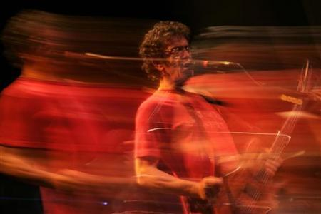 Rock singer-songwriter and guitarist Lou Reed performs during a concert celebrating the 35th year since the release of the ''Berlin'' album, in Malaga, southern Spain July 21, 2008. Picture taken with a long exposure. REUTERS/Jon Nazca