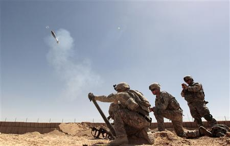 A mortar team from the U.S. Army's Centurion Company, 2-1 Infantry Battalion, 5/2 Stryker Brigade Combat Team fire a 60mm round from a hand held tube outside Combat Outpost Terminator in Maiwand District, Kandahar Province April 21, 2010. REUTERS/Tim Wimborne