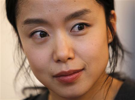 South Korean actress Jeon Do-yeon listens to a reporter's question during an interview with Reuters in Seoul April 21, 2010. REUTERS/Jo Yong-Hak