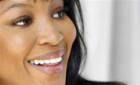 Naomi Campbell smiles during a photo opportunity at Capital City, Europe's tallest building in Moscow, April 26, 2010. REUTERS/Sergei Karpukhin