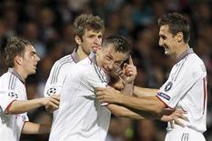 <p>Ivica Olic (2o à direita) comemora gol do Bayern de Munique contra o Olympique Lyon durante semifinal da Liga dos Campeões. REUTERS/Robert Pratta</p>