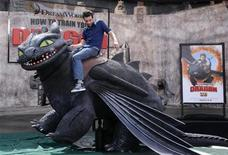 "<p>Cast member Jay Baruchel rides a mechanical dragon at the premiere of the film ""How to Train Your Dragon"" in Los Angeles March 21, 2010. REUTERS/Phil McCarten</p>"