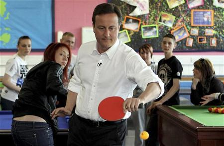 Conservative Party leader David Cameron plays table tennis in the 'Bolton Lads and Girls Club' during an election campaign event in Bolton April 27, 2010. REUTERS/Oli Scarff/Pool