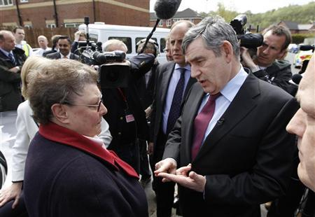 Prime Minister Gordon Brown speaks with resident Gillian Duffy (L) during a campaign stop in Rochdale, northwest England April 28, 2010. REUTERS/Suzanne Plunkett
