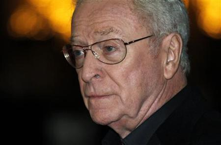 British actor Michael Caine poses for photographers as he arrives for the European premiere of the movie ''Harry Brown'' in London, November 10, 2009. REUTERS/Kevin Coombs