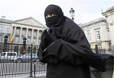 Salma, a 22-year-old French national living in Belgium who chooses to wear the niqab after converting to Islam, gives an interview to Reuters television outside the Belgian Parliament in Brussels in this April 26, 2010 file photo. REUTERS/Yves Herman/Files