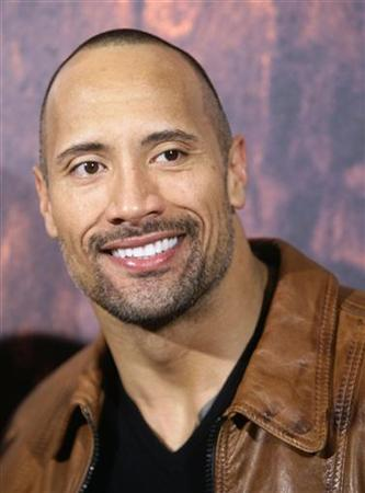 Cast member Dwayne Johnson poses during the Spanish premiere of the film ''Race to Witch Mountain'' in Madrid April 2, 2009. REUTERS/Andrea Comas