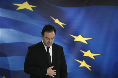 Greece's Finance Minister George Papaconstantinou takes his seat for a news conference in Athens May 2, 2010. Greece has agreed a package of austerity measures with the EU and IMF under which it will cut the deficit by 30 billion euros over three years, Papaconstantinou said on Sunday. REUTERS/John kolesidis