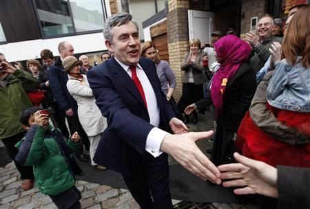 Prime Minister Gordon Brown reaches out to shake hands with a supporter as he leaves a Labour party event in Maida Vale, north London, May 2, 2010. REUTERS/Andrew Winning