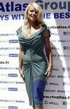 <p>Foto de archivo: la actriz Pamela Anderson posa para los fotógrafos en la localidad costera de Budva, Montenegro, jul 15 2009. REUTERS/Stevo Vasiljevic (MONTENEGRO)</p>