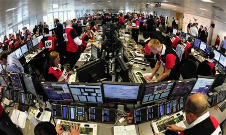 Dealers work on the trading floor of BGC Partners in the Canary Wharf financial district in east London September 11, 2009. REUTERS/Toby Melville