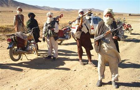 Taliban fighters pose with weapons in an undisclosed location in Afghanistan, August 19, 2009. REUTERS/Stringer