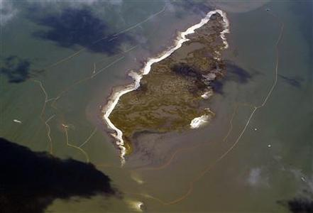 A double layer of oil booms are set up around one of the Chandeleur Islands, Louisiana May 7, 2010 as seen from a plane used by the environmental group Mobile Baykeeper and Southwings to look at the damage caused by the oil spill. REUTERS/Brian Snyder