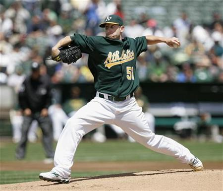 Oakland Athletics pitcher Dallas Braden throws against the New York Yankees in the first inning of their MLB American League baseball game in Oakland, California, April 22, 2010. Reuters/Kim White