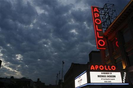 A marquee displays a memorial message during the Michael Jackson public memorial at the Apollo Theater in New York, June 30, 2009. REUTERS/Lucas Jackson