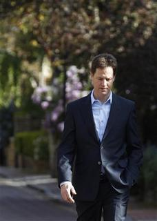 Liberal Democrat Party leader Nick Clegg walks back to his house in London May 11, 2010. REUTERS/Andrew Winning
