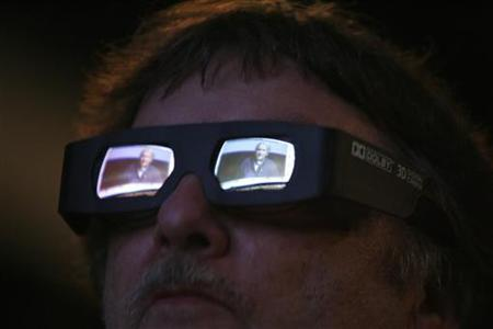 Director, writer and producer James Cameron is reflected in a visitor's 3D glasses as he speaks at a panel discussion for his upcoming movie ''Avatar'' during the 40th annual Comic Con Convention in San Diego, July 23, 2009. REUTERS/Mario Anzuoni