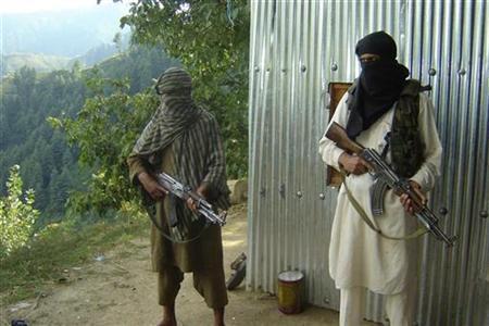 Masked Pakistani pro-Taliban militants are seen in Pakistan in a 2008 file photo. REUTERS/Adil Khan
