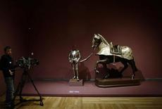 "<p>A cameraman films the ""Armour of Philip II called the Burgundy Cross Armour"" by Wolfgang Grosschedel during the media presentation of the exhibit ""The Art of Power. The Royal Armoury and court portraiture"" at Madrid's Prado Museum March 8, 2010. REUTERS/Susana Vera</p>"