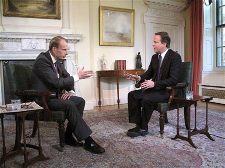 Prime Minister David Cameron is interviewed by BBC journalist Andrew Marr in his official residence of 10 Downing Street in London May 16, 2010. REUTERS/Jeff Overs/BBC