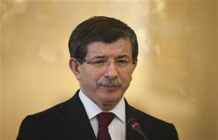 Turkish Foreign Minister Ahmet Davutoglu attends a joint news conference with his Iranian counterpart Manouchehr Mottaki in Tehran April 20, 2010. REUTERS/Morteza Nikoubazl