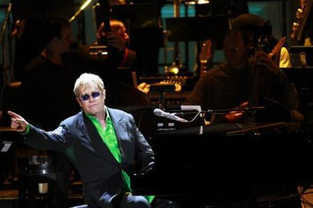 Singer Sir Elton John performs during the 21st birthday celebration for the Rainforest Fund at Carnegie Hall in New York May 13, 2010. REUTERS/Lucas Jackson